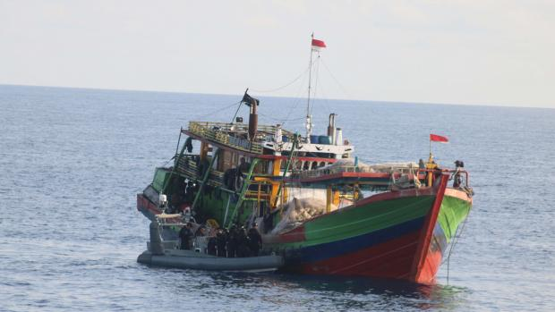 Australian Border Force boarding an Indonesian fishing vessel suspected of illegal fishing